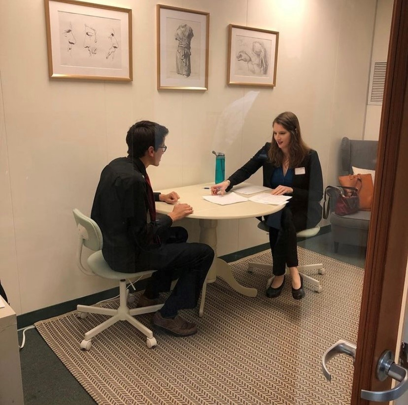 MedBridge employee assisting a student with their resume